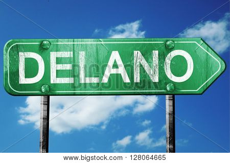 delano road sign , worn and damaged look