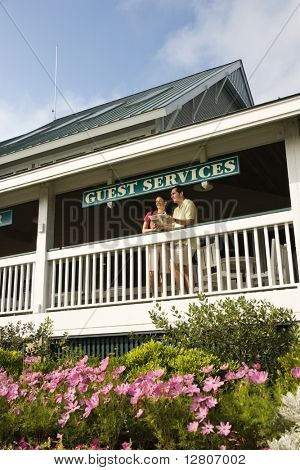 Mid-adult couple on deck of guest services at Bald Head Island, North Carolina.
