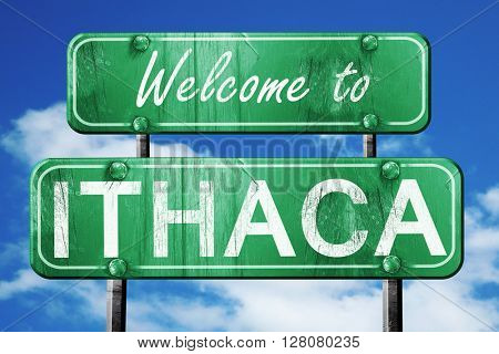 ithaca vintage green road sign with blue sky background