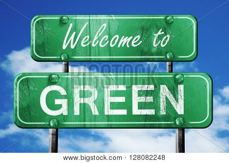 green vintage green road sign with blue sky background