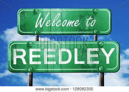 reedley vintage green road sign with blue sky background