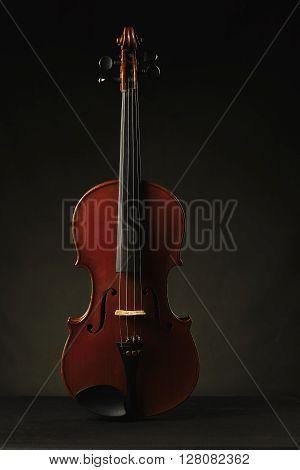 photo of aged violin on dark background