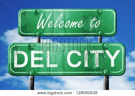 del city vintage green road sign with blue sky background