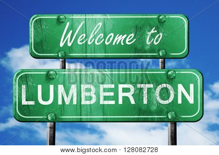lumberton vintage green road sign with blue sky background
