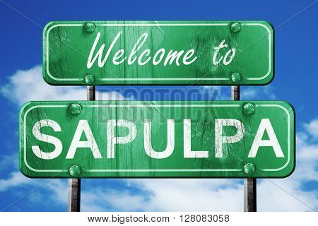 sapulpa vintage green road sign with blue sky background