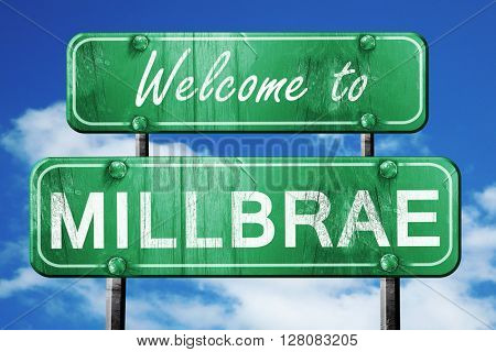 millbrae vintage green road sign with blue sky background
