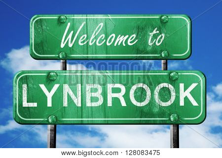 lynbrook vintage green road sign with blue sky background