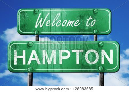 hampton vintage green road sign with blue sky background