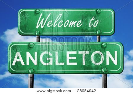 angleton vintage green road sign with blue sky background