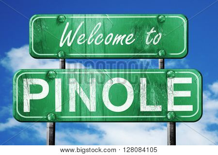 pinole vintage green road sign with blue sky background