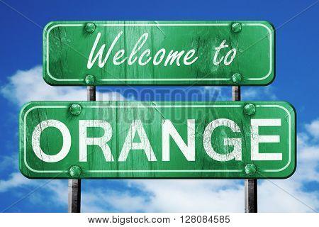 orange vintage green road sign with blue sky background