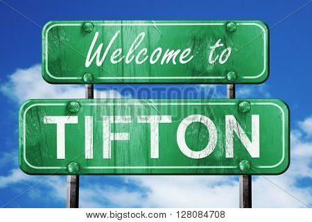 tifton vintage green road sign with blue sky background