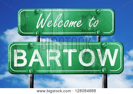 bartow vintage green road sign with blue sky background