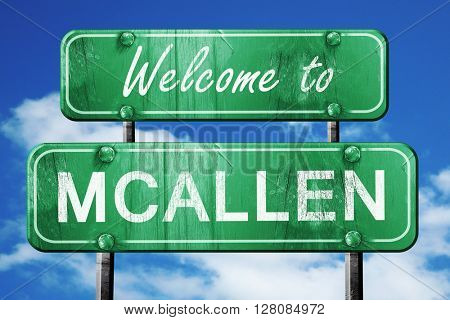 mcallen vintage green road sign with blue sky background