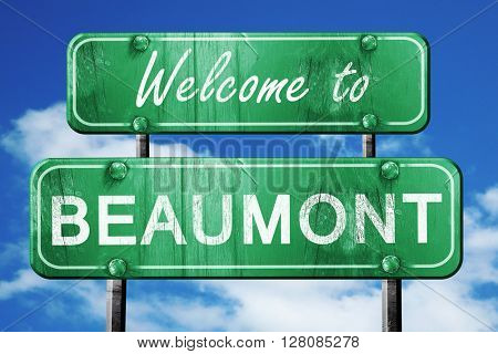 beaumont vintage green road sign with blue sky background