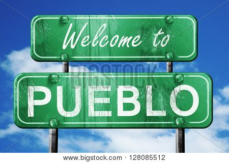 pueblo vintage green road sign with blue sky background