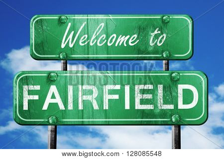 fairfield vintage green road sign with blue sky background