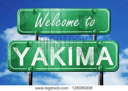 yakima vintage green road sign with blue sky background
