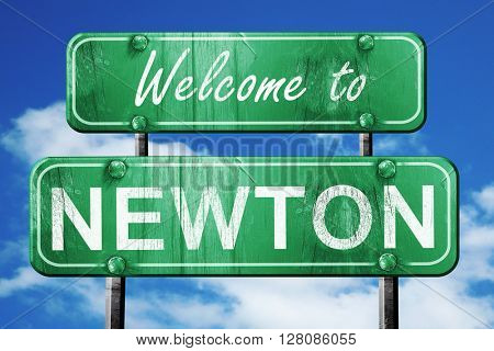 newton vintage green road sign with blue sky background