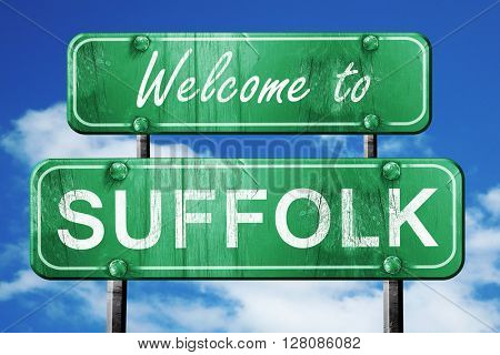 suffolk vintage green road sign with blue sky background