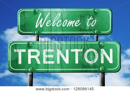 trenton vintage green road sign with blue sky background
