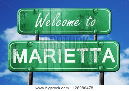 marietta vintage green road sign with blue sky background