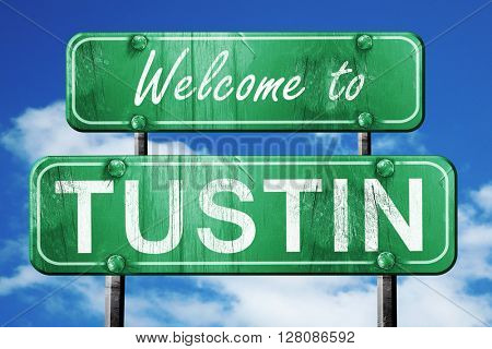 tustin vintage green road sign with blue sky background