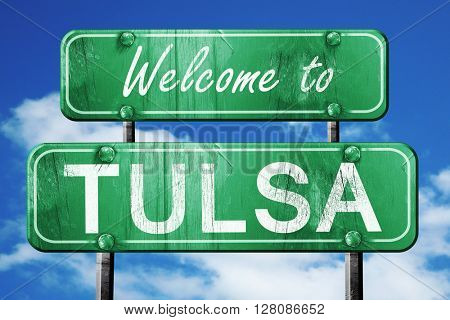 tulsa vintage green road sign with blue sky background