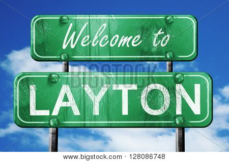 layton vintage green road sign with blue sky background