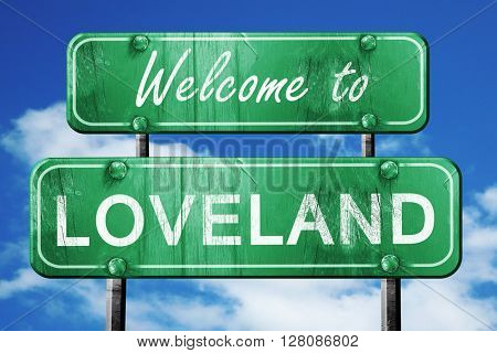 loveland vintage green road sign with blue sky background