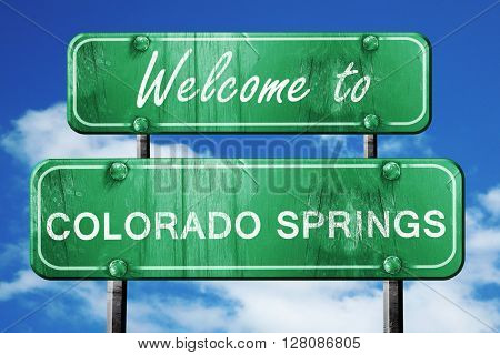 colorado springs vintage green road sign with blue sky backgroun