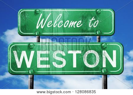 weston vintage green road sign with blue sky background