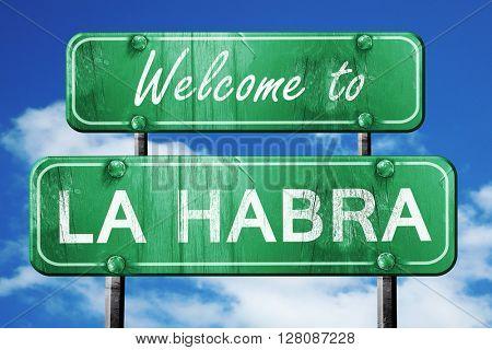 la habra vintage green road sign with blue sky background