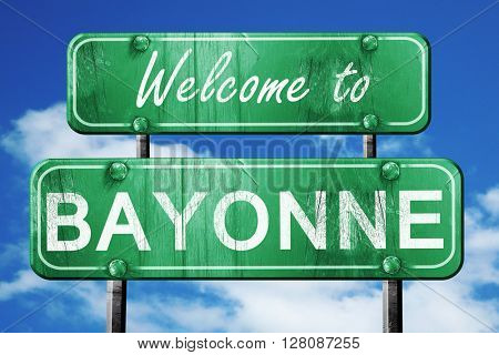 bayonne vintage green road sign with blue sky background