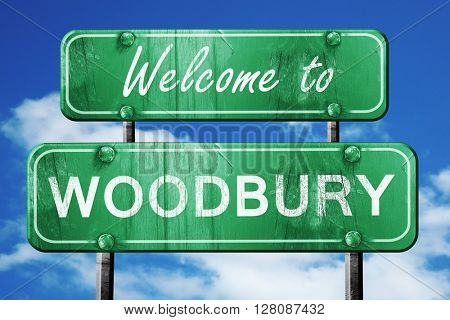 woodbury vintage green road sign with blue sky background