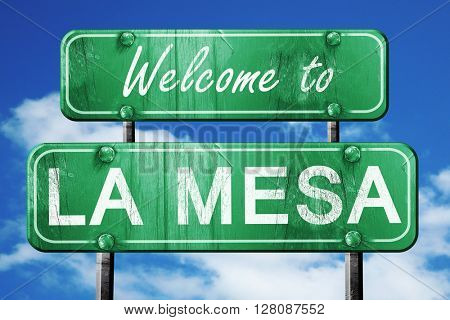 la mesa vintage green road sign with blue sky background