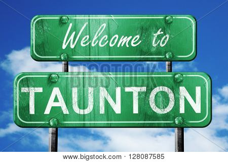 taunton vintage green road sign with blue sky background