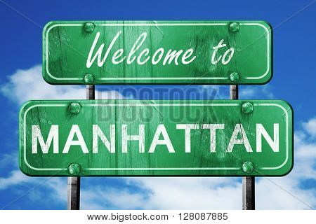 manhattan vintage green road sign with blue sky background