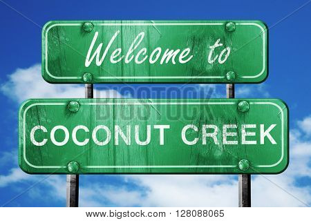 coconut creek vintage green road sign with blue sky background
