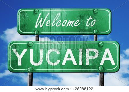 yucaipa vintage green road sign with blue sky background