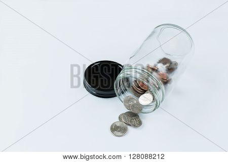 A tight shot of a change jar against a white background