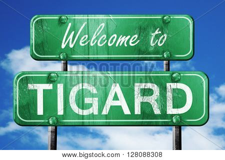 tigard vintage green road sign with blue sky background