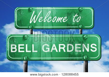 bell gardens vintage green road sign with blue sky background