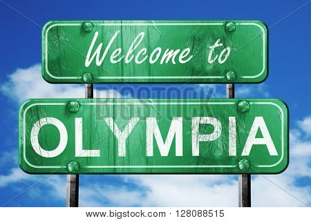 olympia vintage green road sign with blue sky background