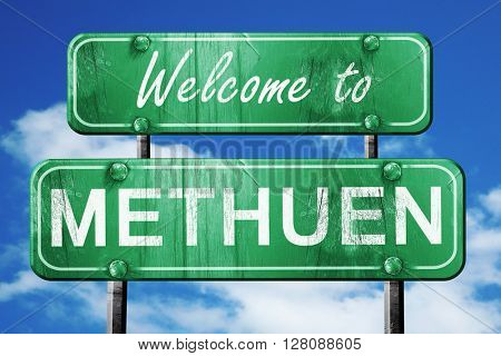methuen vintage green road sign with blue sky background