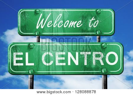 el centro vintage green road sign with blue sky background