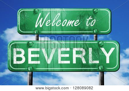 beverly vintage green road sign with blue sky background