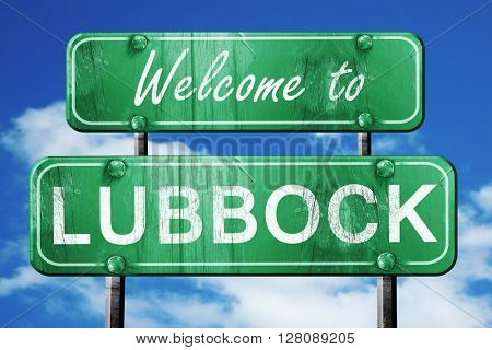 lubbock vintage green road sign with blue sky background