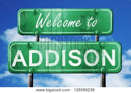 addison vintage green road sign with blue sky background