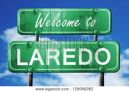 laredo vintage green road sign with blue sky background